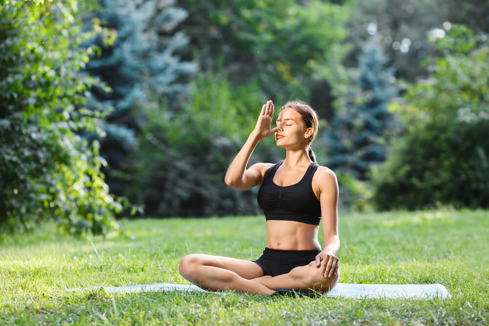 Woman in yoga position outdoors