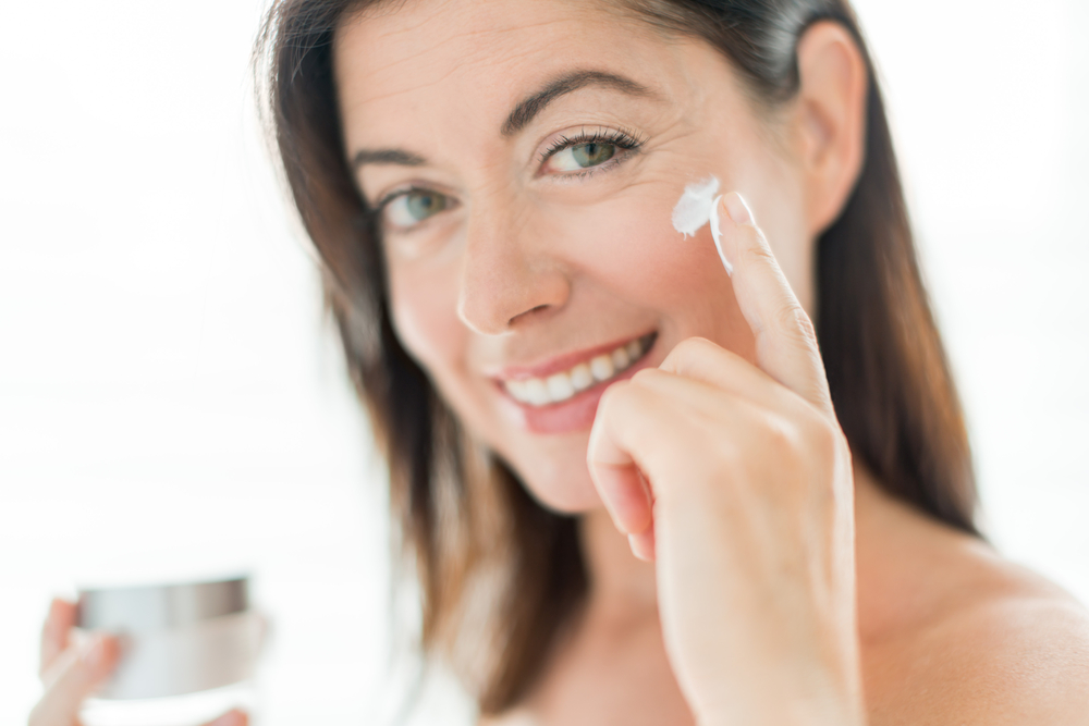 Woman with face product