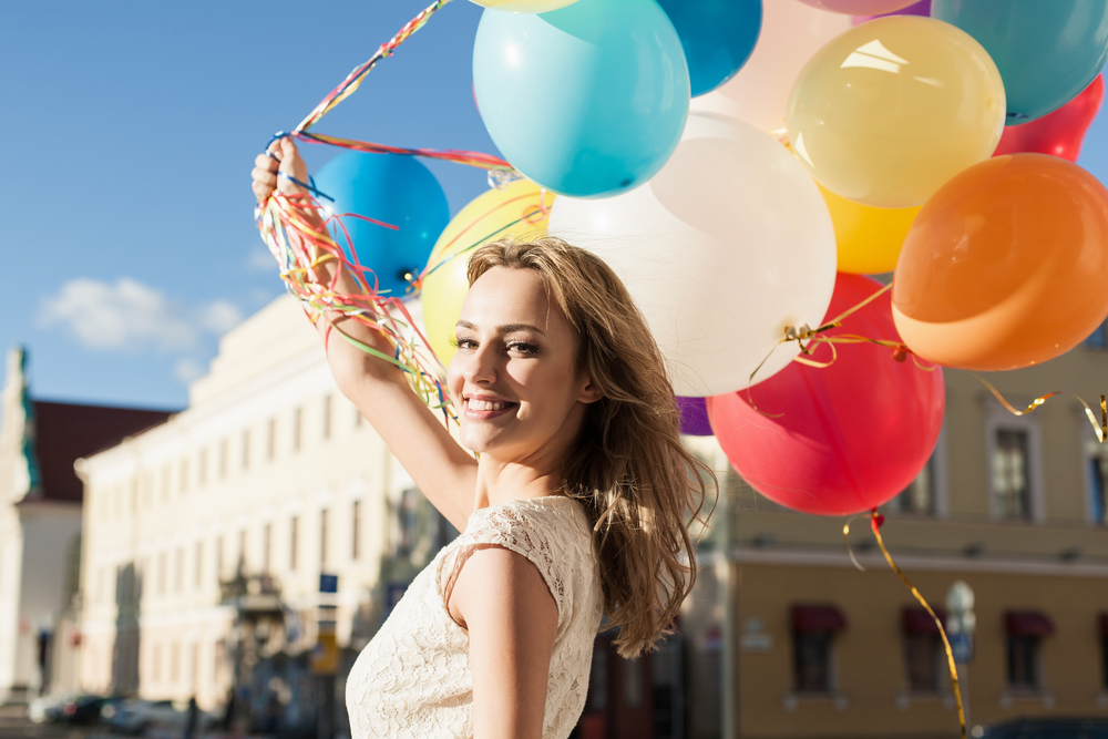 Youthful girl with balloons