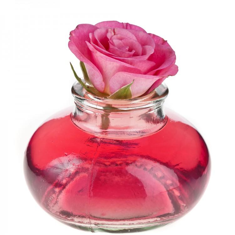 Image of a pink rose on a bottle of rose oil