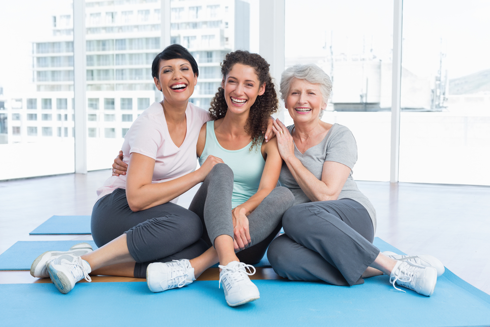 Group of happy women in a yoga class.