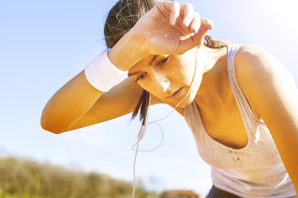Woman sweating after exercise.
