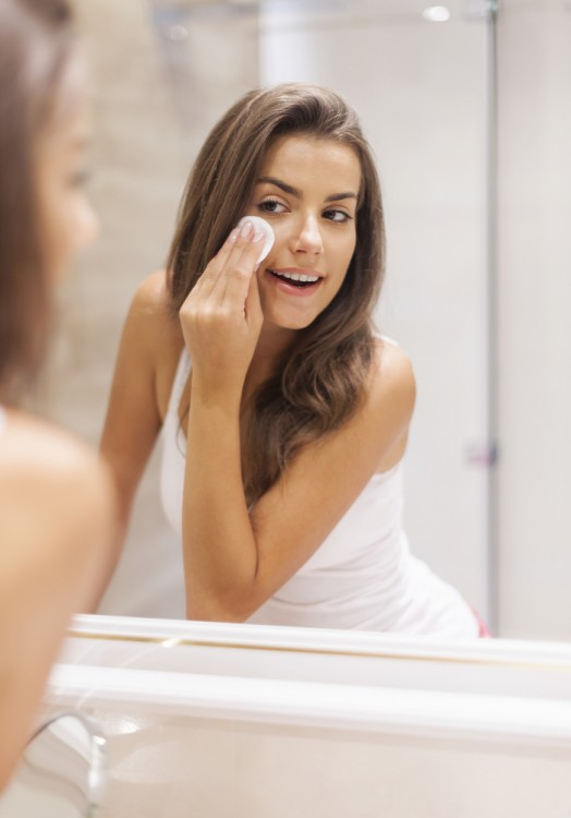 Woman removing her makeup before going to sleep.
